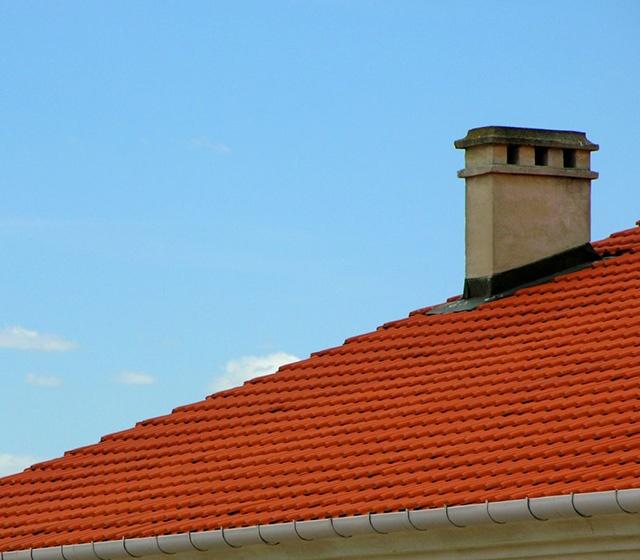 Retour de fumée poêle à bois sortie de toit